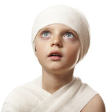 a little girl with a bandage