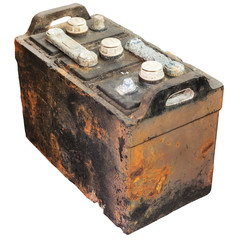 Rusty old car battery isolated on white