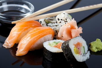 Sushi with sauce and chopsticks.