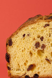 Texture of Panettone, Christmas cake over a red background