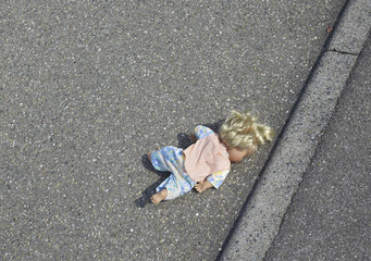 doll on the street