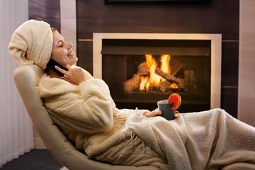 Happy woman relaxing in beauty mask