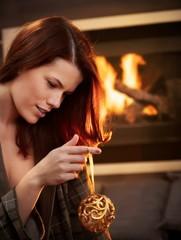 Young woman with christmas bulb