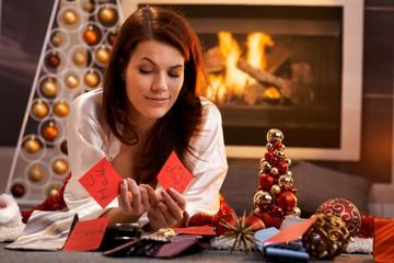Smiling girl decide on christmas presents