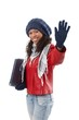 Pretty ethnic woman waving at wintertime