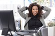 Smart businesswoman sitting at desk smiling