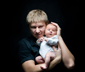father and his newborn baby daughter