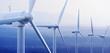 Leinwanddruck Bild - Wind Turbines with distant mountains