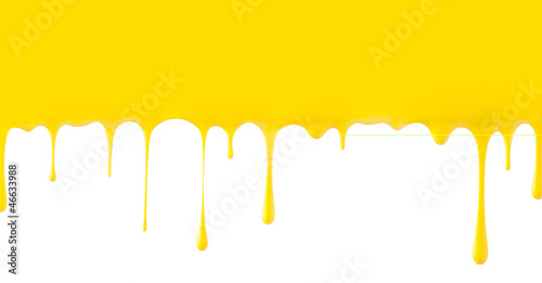 Yellow paint dripping isolated on white background