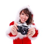 Pretty Mrs. Santa with retro camera