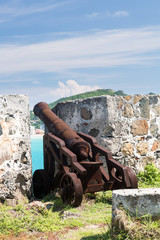 Old cannon rusting on St Martin Caribbean