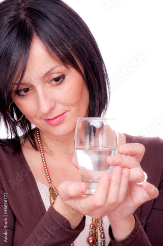 Woman and half full glass of water
