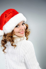 Attractive young woman in red Santa hat