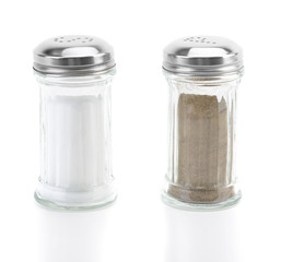 Glass salt and pepper shakers on white background