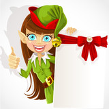 Girl the Christmas elf with a banner for your congratulation