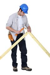 Tradesman nailing a frame