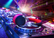 Leinwanddruck Bild - Dj mixer with headphones