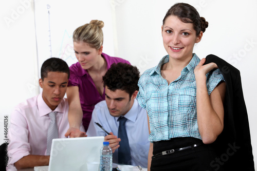 businessmen and businesswomen working at the office