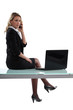 Sexy businesswoman sitting on a desk