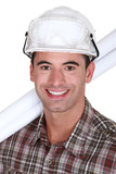 Close-up shot of a grinning tradesman