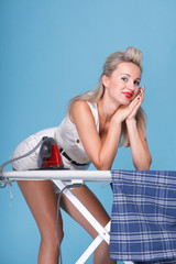 pin up girl retro style woman ironing sharing the chores