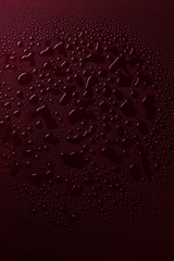 Water drops on red surface