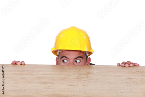 Entrepreneur hiding behind a table