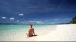 Woman in Santa Hat on tropical beach