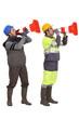 Men using traffic cones as loudspeakers