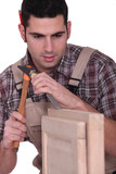 Man using hammer and chisel