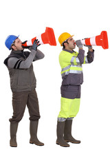 Men using traffic cones as loudspeakers