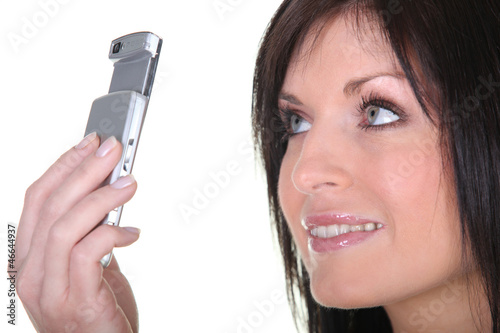 Woman taking picture with mobile phone
