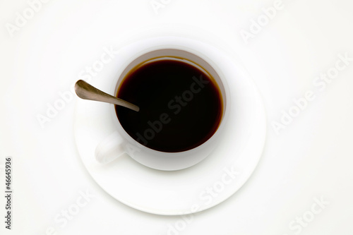 cup of black coffee with a spoon, top view