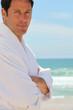 Man on the beach in bath robes