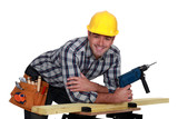 Carpenter posing with power drill
