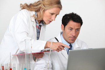 Chemists looking at laptop