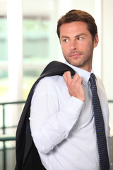 Businessman with jacket over shoulder