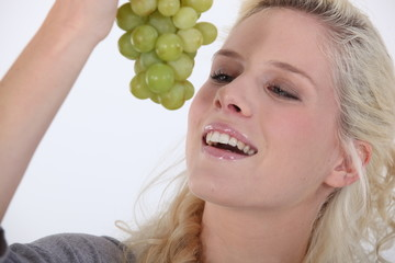 Woman with a bunch of grapes