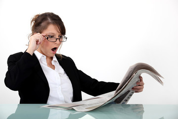 Businesswoman shocked at her newspaper