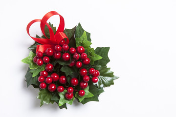 Christmas berries garland with red ribbon over white
