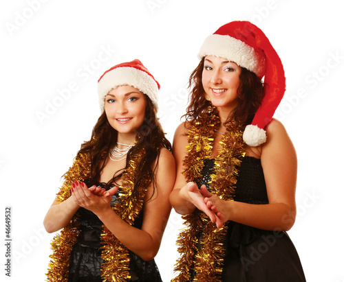 Two young women in Christmas hat clapping hands