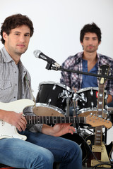 Youth with guitar and drums