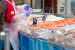 Fresh atlantic salmon lie on table with ice in supermarket. Sell