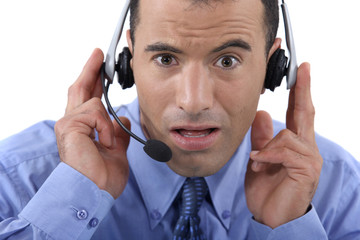 Call centre operator looking shocked