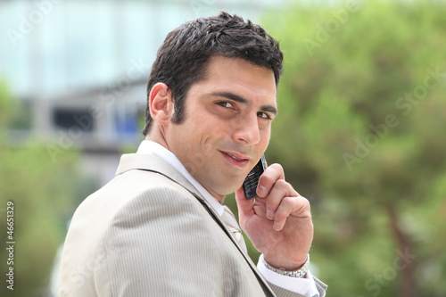 Executive using a cellphone outside