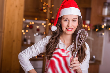 Woman is cooking for Christmas in the kitchen.