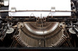 Old typewriter with a sheet of paper