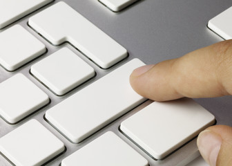 White keyboard and hand