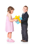 Little boy  giving a gift box to her girlfriend