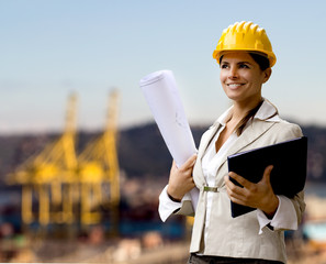 female naval engineer against shipyard background